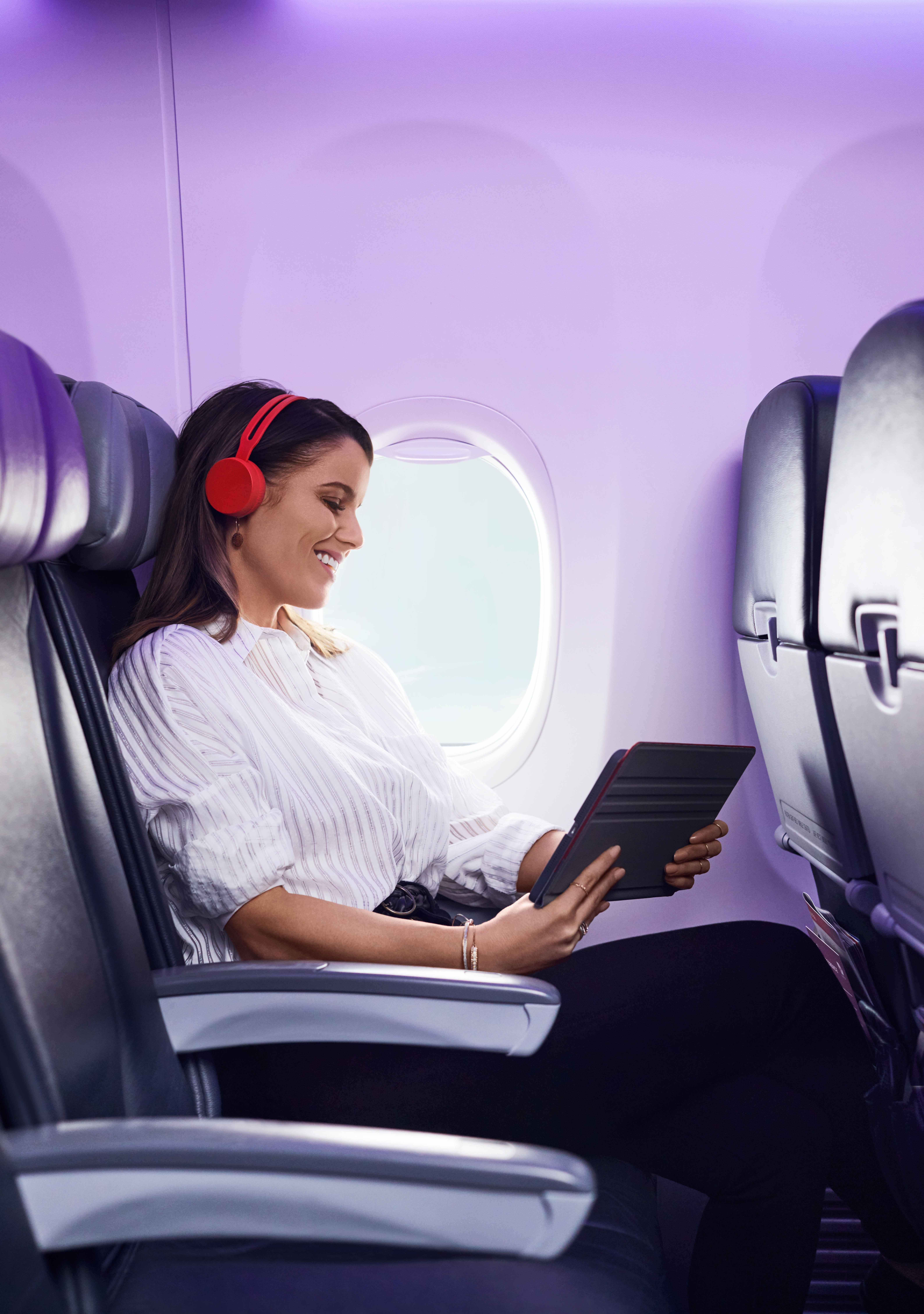Lady enjoying Virgin Australia flight